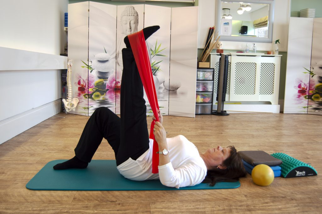 Angie Appleton demonstrating Pilates in the Pilates Studio